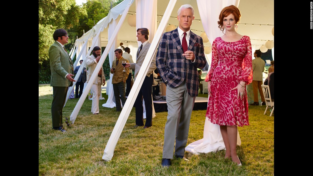 Roger Sterling (John Slattery) and Joan Harris (Christina Hendricks) dress casually -- for the times -- for an outdoor party.