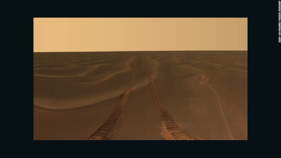 Opportunity photographed its tracks in the soft sand between the Endurance and Victoria craters, on the Meridiani Plains.