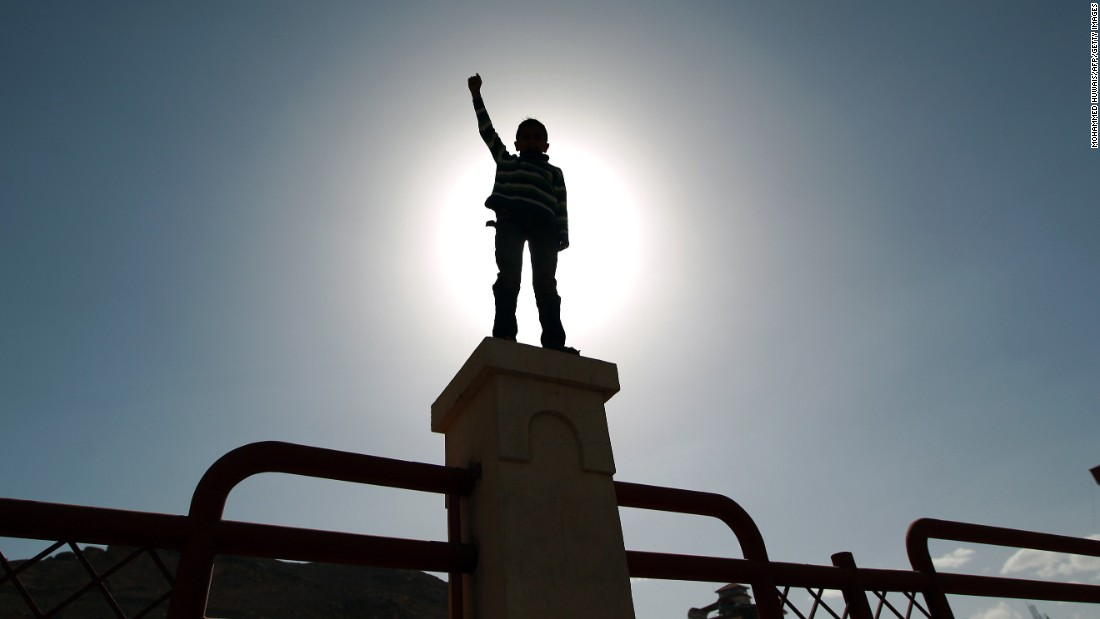 A child raises his fist during a rally by Houthi supporters in Sanaa on Friday, March 6.