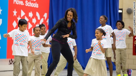 "First Lady Michelle Obama participates in musical activities with students during a back to school ""Let's Move!"" Active Schools event at Orr Elementary School in Washington, D.C., Sept. 6, 2013. (Official White House Photo by Chuck Kennedy)"