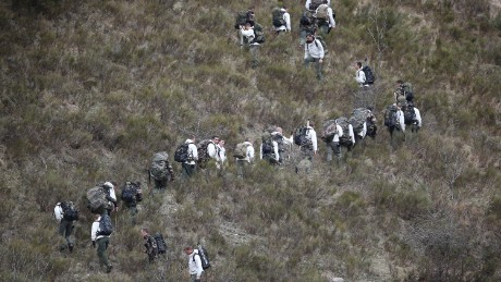 SEYNE, FRANCE - MARCH 25: French military personel walk up the mountainside on March 25, 2015 near Seyne, France. Germanwings flight 4U9525 from Barcelona to Duesseldorf has crashed in Southern French Alps. All 150 passengers and crew are thought to have died. (Photo by Peter Macdiarmid/Getty Images) *** BESTPIX ***
