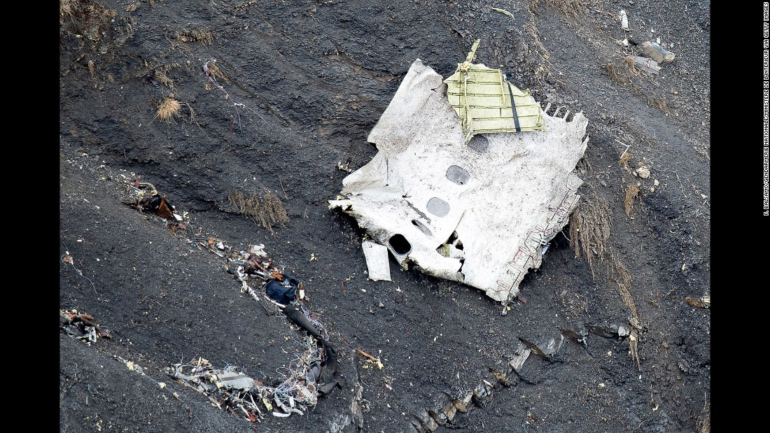 Debris from the plane is seen along a mountainside in the French Alps on March 25.