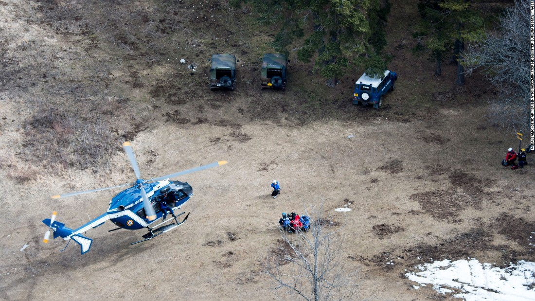 Search and rescue teams land near the crash site on Wednesday, March 25.