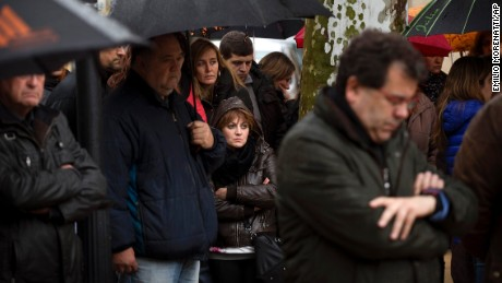 People pay a moment of silence in Llinars del Valles, Spain, on Wednesday, March 25.