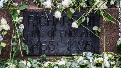 LEICESTER, UNITED KINGDOM - MARCH 26:  White roses adorn the statue of Richard III outside Leicester Cathedral before the reinterment ceremony of King Richard III, on March 26, 2015 in Leicester, England. The skeleton of King Richard III was discovered in 2012 benaeth a car park, in the foundations of Greyfriars Church in Leicester, 500 years after he was killed in the Battle of Bosworth Field. (Photo by Richard Pohle - WPA Pool/Getty Images)