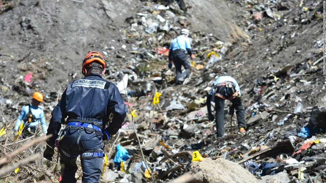 Rescue workers continue to search the site of the Germanwings plane crash on March 26.