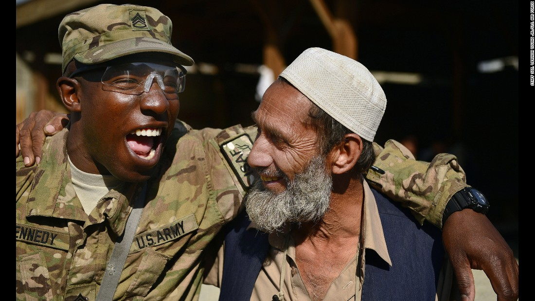 U.S. Army Staff Sgt. Damion Kennedy shares a laugh with an Afghan man as he helps oversee a base detail project April 8, 2014, in Afghanistan. Kennedy and many of his fellow soldiers developed strong connections with Afghans during their deployment.