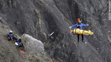 A rescue worker is lifted into an helicopter at the crash site near Seyne-les-Alpes, France, Thursday, March 26, 2015. The co-pilot of the Germanwings jet barricaded himself in the cockpit and ìintentionallyî rammed the plane full speed into the French Alps, ignoring the captainís frantic pounding on the cockpit door and the screams of terror from passengers, a prosecutor said Thursday. In a split second, he killed all 150 people aboard the plane. (AP Photo/Laurent Cipriani)