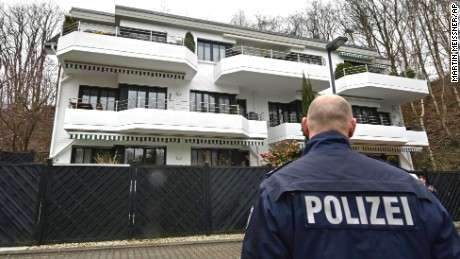 """A police officer stands in front of an apartment building where they believe Andreas Lubitz, the co-pilot of the crashed Germanwings airliner jet, lived in Duesseldorf, Germany, Thursday, March 26, 2015, during an investigation into the crash in the French Alps on Tuesday that killed 150 people. Lubitz barricaded himself in the cockpit and """"intentionally"""" sent the plane full speed into a mountain, ignoring the pilot's frantic pounding on the door and the screams of terror from passengers, a prosecutor said Thursday. (AP Photo/Martin Meissner)"""