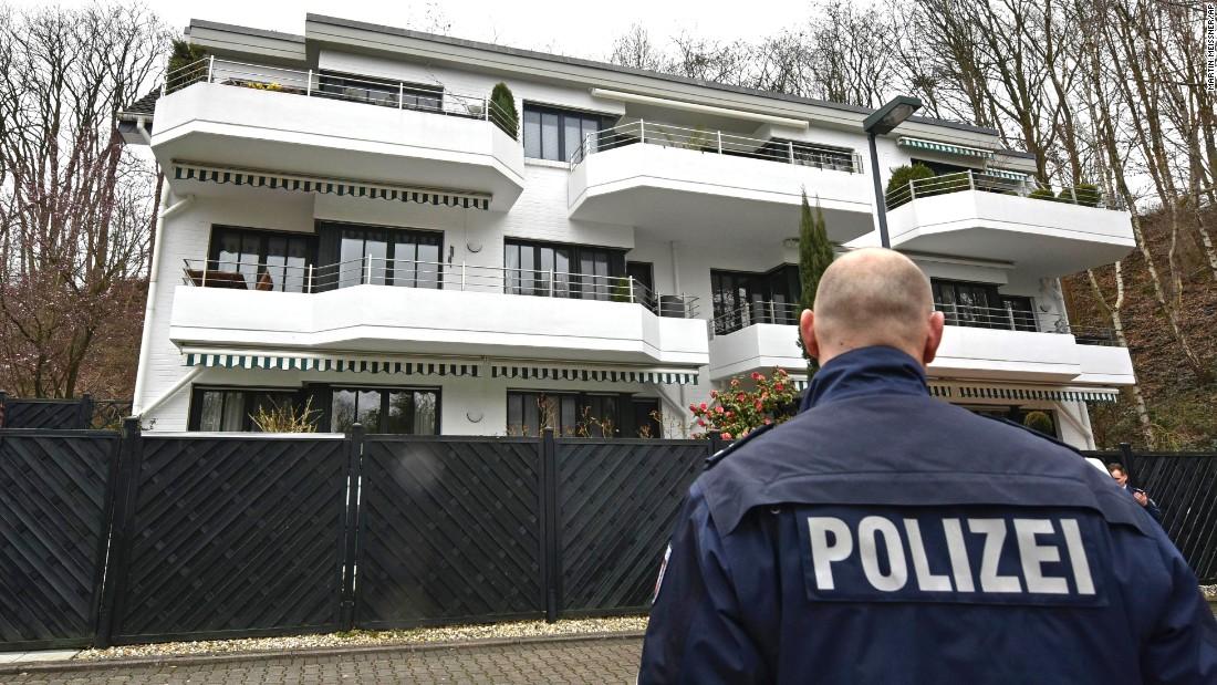 A police officer stands guard on March 26 at an apartment building where Lubitz was thought to have lived in Dusseldorf.