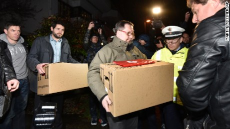 """Investigators carry boxes from the apartment of Germanwings airliner jet co-pilot Andreas Lubitz, in Duesseldorf, Germany, Thursday March 26, 2015. On Thursday, French prosecutors said Lubitz, the co-pilot of Germanwings Flight 9525, """"intentionally"""" crashed the jet into the side of a mountain Tuesday in the French Alps. (AP Photo/Martin Meissner)"""
