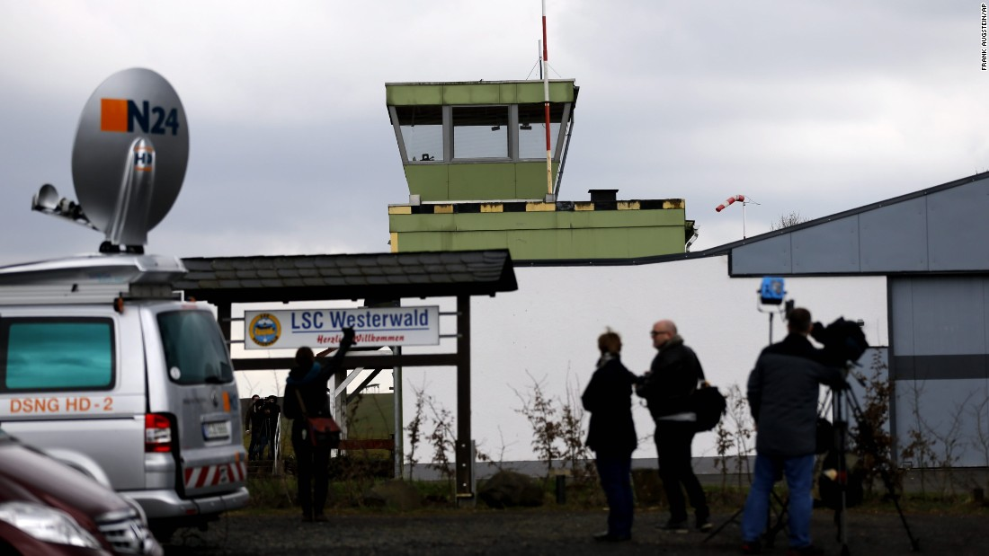 Journalists stand in front of the Westerwald airfield in Montabaur, Germany, on March 27. Andreas Lubitz, co-pilot of Germanwings Flight 9525, reportedly learned to fly here. Information collected by investigators suggests Lubitz was alone at the controls of the plane and deliberately crashed it in the French Alps on Tuesday, March 24, a prosecutor said.