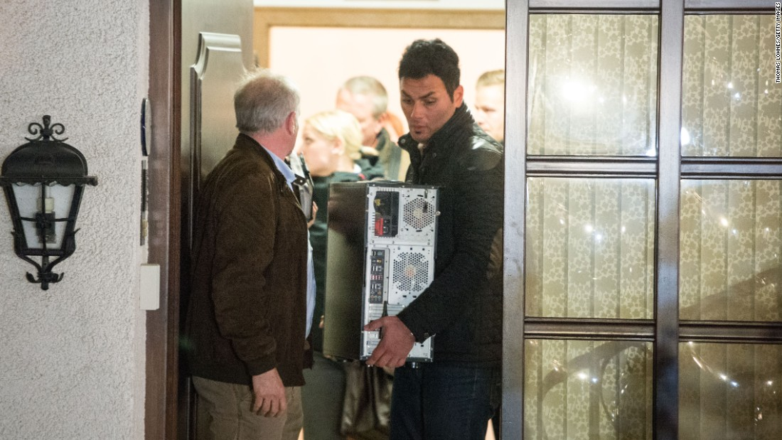 Investigators carry a computer from Lubitz's parents' home in Montabaur on March 26.