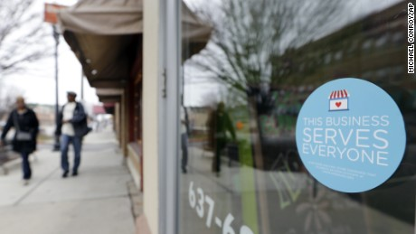 A window sticker on a downtown Indianapolis florist, Wednesday, March 25, 2015, shows it's objection to the Religious Freedom bill passed by the Indiana legislature. Organizers of a major gamers' convention and a large church gathering say they're considering moving events from Indianapolis over a bill that critics say could legalize discrimination against gays. (AP Photo/Michael Conroy)