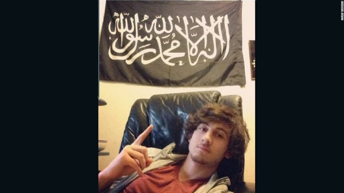 Authorities are releasing evidence in the trial of accused Boston Marathon bomber Dzhokhar Tsarnaev. Be warned: Some of the images in this gallery are graphic. Here, Tsarnaev poses in front of a black standard adopted by various militant Islamist groups in an Instagram photo entered as court evidence.