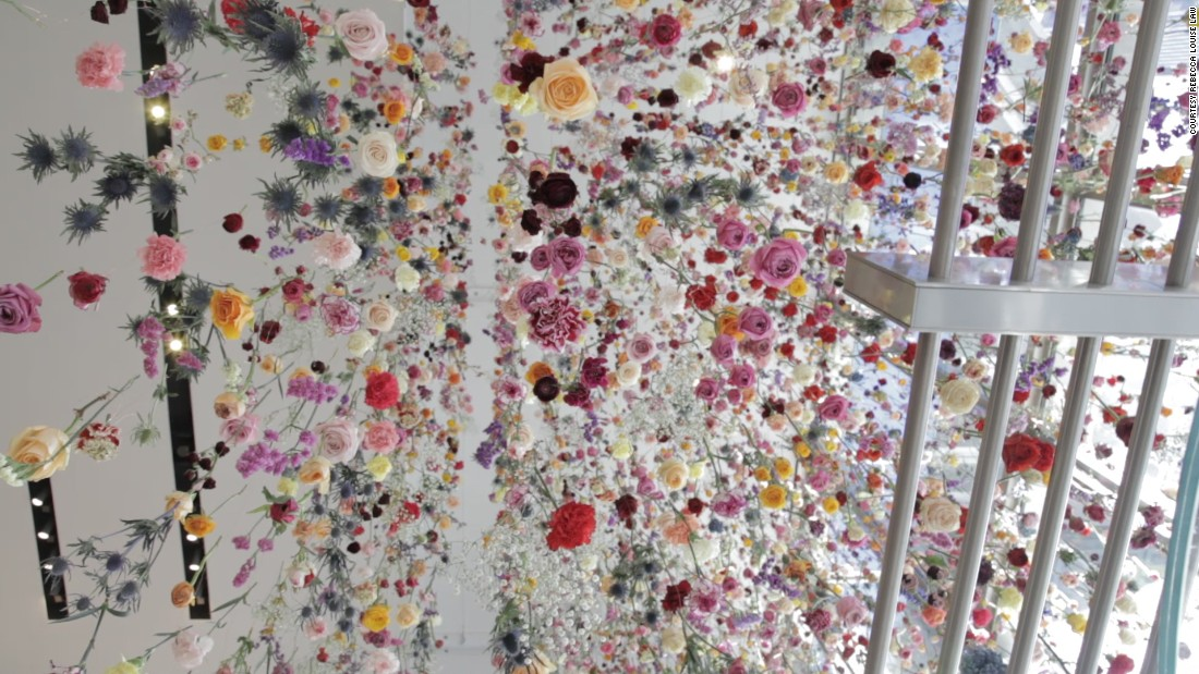 In Times Square, Law hung 16,000 flowers that gradually dried above visitors. Over the years she has developed techniques to best preserve her flowers, consulting with experts at the Victoria and Albert Museum in London.