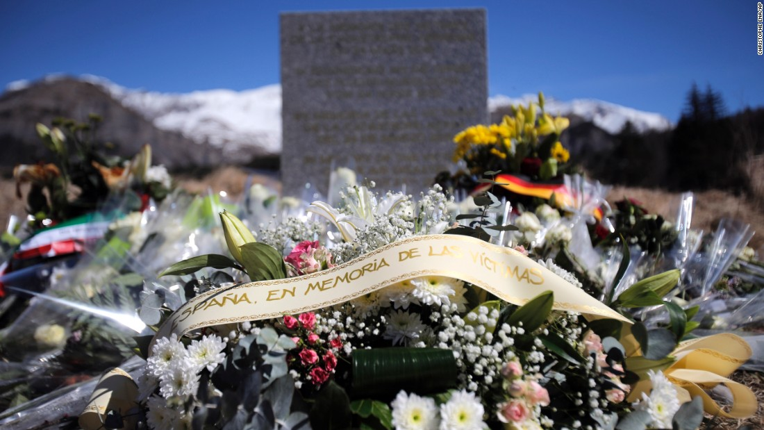 Flowers laid in memory of the victims on Friday, March 27, are placed in the area where the Germanwings jetliner crashed in the French Alps, in Le Vernet, France.