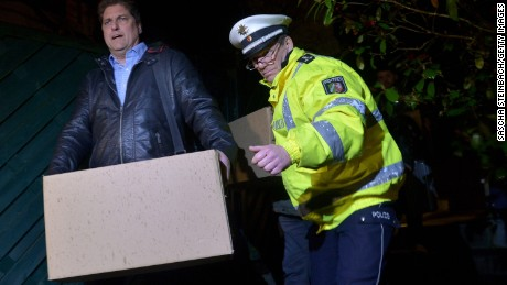 Investigators carry boxes from the apartment of Andreas Lubitz, the co-pilot on Germanwings flight 4U9525, on March 26, 2015 in Dusseldorf, Germany.