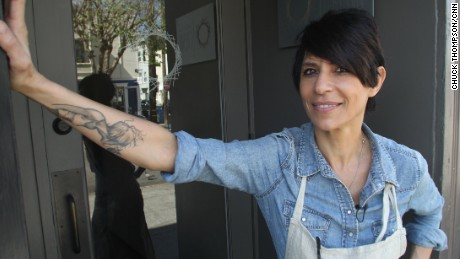 Chef/owner Dominique Crenn in front of Atelier Crenn restaurant in San Francisco, March 2015.