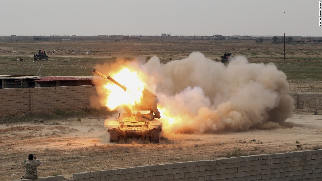 Iraqi security forces launch rockets against ISIS positions in Tikrit on Saturday, March 28.