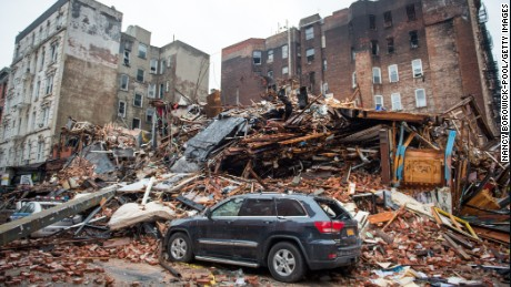 A debris-strewn street seen amid the site of a seven-alarm fire that caused the collapse of two buildings and damage to two other buildings a day after the blaze took place on March 27, 2015 in New York City. At least two people are missing and over a dozen injured.