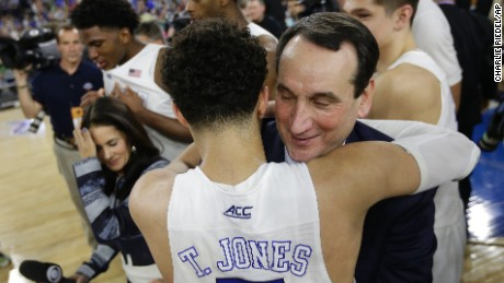 Duke head coach Mike Krzyzewski hugs Tyus Jones (5) after a college basketball regional final game in the NCAA Tournament Sunday, March 29, 2015, in Houston. Duke defeated Gonzaga 66-52 to advance to the Final Four.