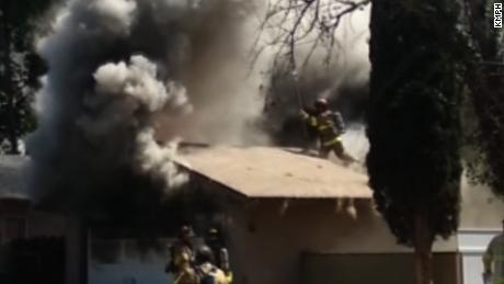 Firefighter Falls Through Burning Roof Cnn Video