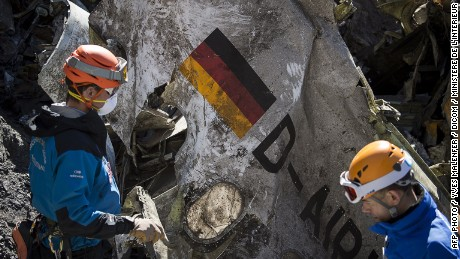 Gendarmes and rescuers from the Gendarmerie High-Mountain Rescue Group working at the crash site of the Germanwings Airbus A320 near Le Vernet, French Alps.