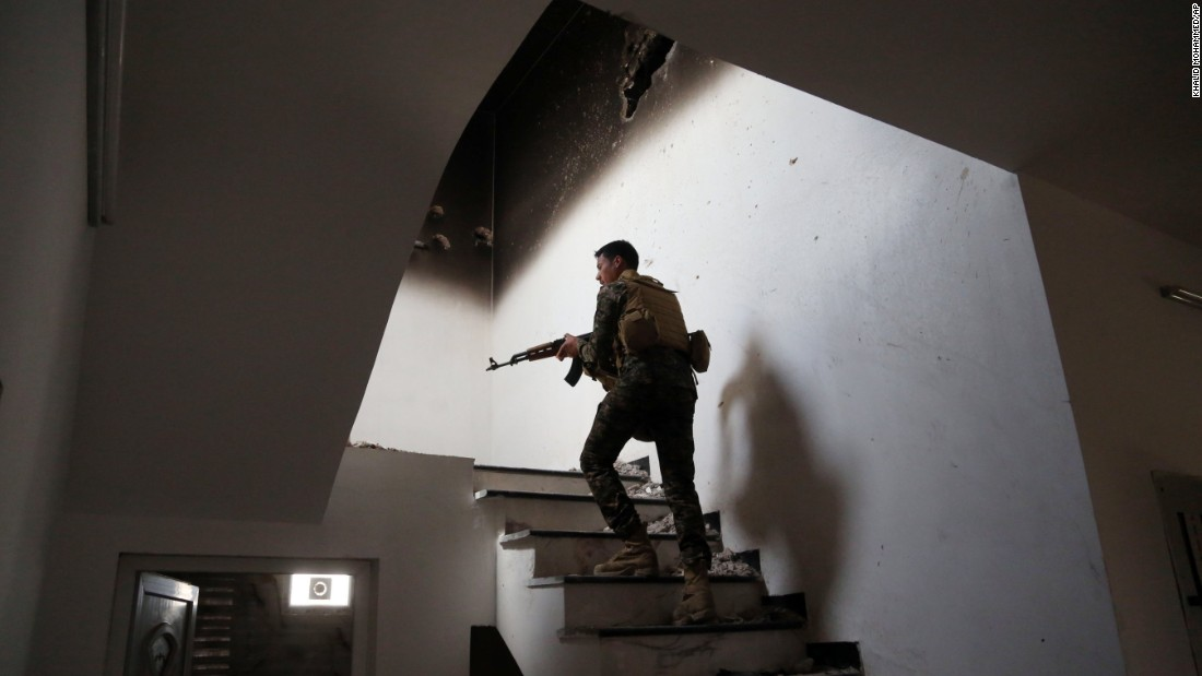 An Iraqi soldier searches for ISIS fighters in Tikrit on March 30.