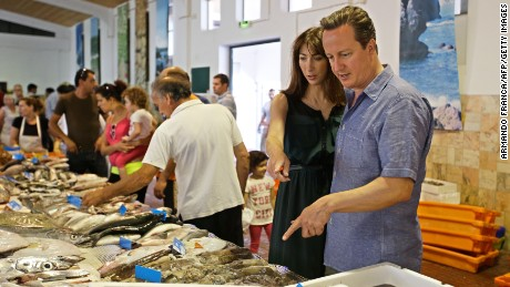 British Prime Minister David Cameron and his wife Samantha visit a fish market while on holiday in Aljezur, in the southwestern coast of Portugal, on July 26, 2013.