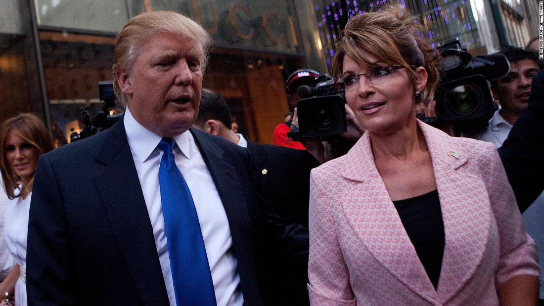 Former U.S. vice presidential candidate and Alaska Gov. Sarah Palin and Trump walk toward a limousine after leaving Trump Tower, at 56th Street and 5th Avenue, on May 31, 2011, in New York City.