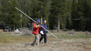 California Gov. Jerry Brown, right, walks with Frank Gehrke, chief of the California Cooperative Snow Surveys Program for the Department of Water Resources, near Echo Summit, California, on Wednesday, April 1. Gehrke said this was the first time since he has been conducting the survey that he found no snow at this location at this time of the year.
