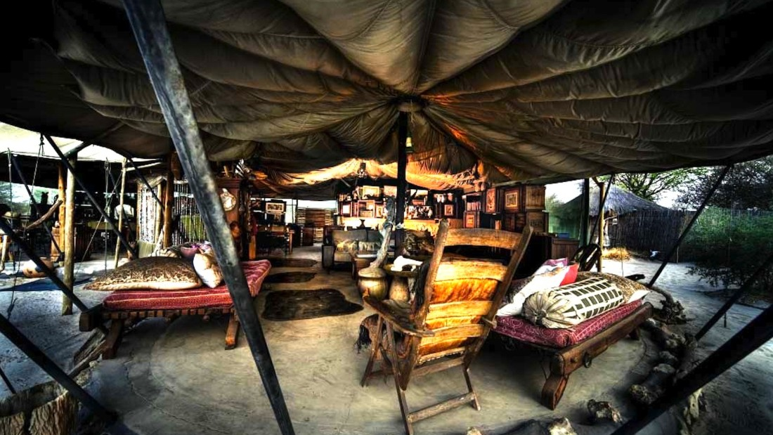 """""""This family-run lodge lies under a riverine canopy on the Boteti River, one of northern Botswana's so-called """"miracle rivers."""" The lodge has the lightest of footprints -- its lounge roof is a parachute."""""""