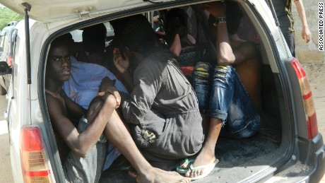 Students of the Garissa University College take shelter in a vehicle after fleeing from an attack by gunmen in Garissa, Kenya, Thursday, April 2, 2015. Gunmen attacked the university early Thursday, shooting indiscriminately in campus hostels. Police and military surrounded the buildings and were trying to secure the area in eastern Kenya, police officer Musa Yego said. (AP Photo)