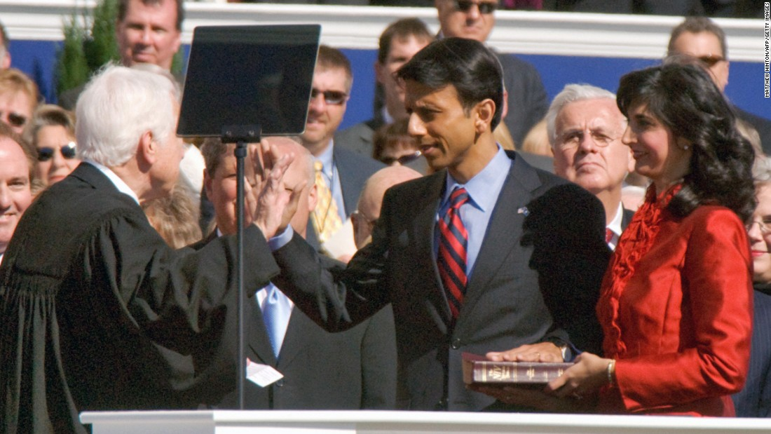 Jindal takes the oath of office on January 14, 2008 -- becoming the country's first Indian-American governor -- while his wife Supriya holds the Bible.