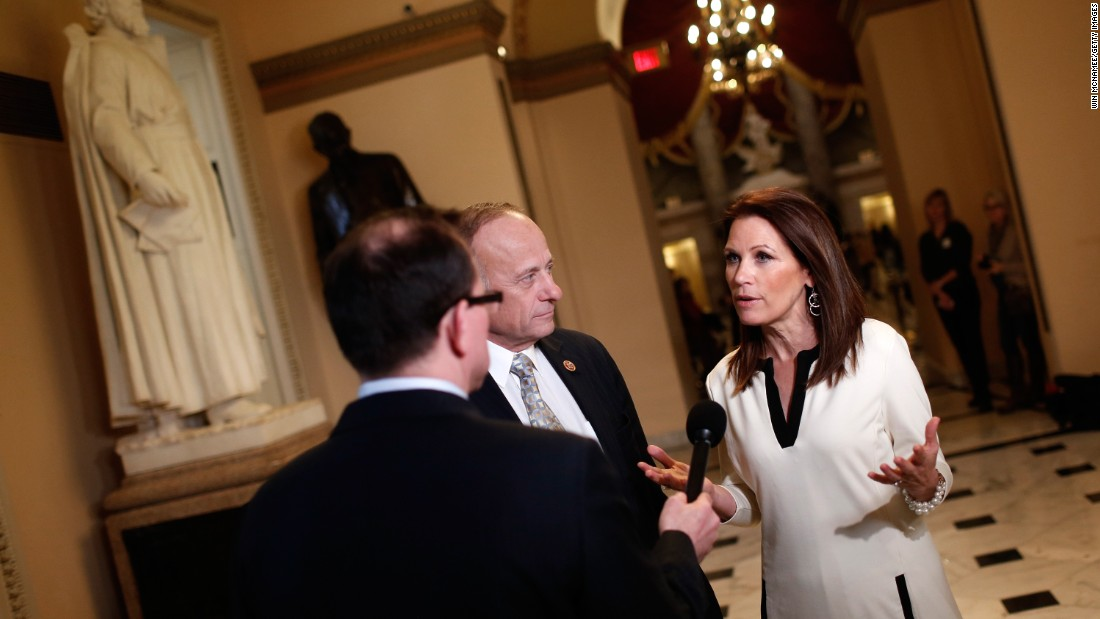 Rep. Michele Bachmann, R-Minnesota, right, and Rep. Steve King, R-Iowa, center, talk with a reporter at the U.S. Capitol as the House of Representatives continues a temporary recess on December 11, 2014, during her last month in office. Here's a look back at her political career.
