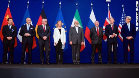 From left, Head of Mission of People's Republic of China to the European Union Hailong Wu, French Foreign Minister Laurent Fabius, German Foreign Minister Frank-Walter Steinmeier, European Union High Representative for Foreign Affairs and Security Policy Federica Mogherini, Iranian Foreign Minister Javad Zarifat, an unidentified Russian official, British Foreign Secretary Philip Hammond, and U.S. Secretary of State John Kerry pose for a photo following negotiations between the P5+1 member nations and Iranian officials about the future of their country's nuclear program at the École Polytechnique Fédérale de Lausanne in Switzerland on April 2, 2015.