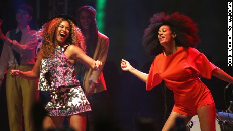 INDIO, CA - APRIL 12: Singers Beyonce (L) and Solange perform onstage during day 2 of the 2014 Coachella Valley Music & Arts Festival at the Empire Polo Club on April 12, 2014 in Indio, California.  (Photo by Imeh Akpanudosen/Getty Images for Coachella)