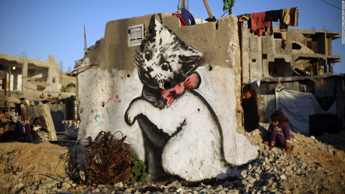 150402191039-02-banksy-gaza-cat-super-169 - Welcome to Dismaland - Weird and Extreme