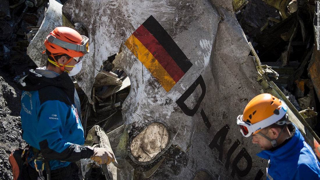 Rescue workers recover debris from the crash site in the French Alps on Tuesday, March 31. Flight 9525 was traveling from Barcelona, Spain, to Dusseldorf, Germany, when it crashed.