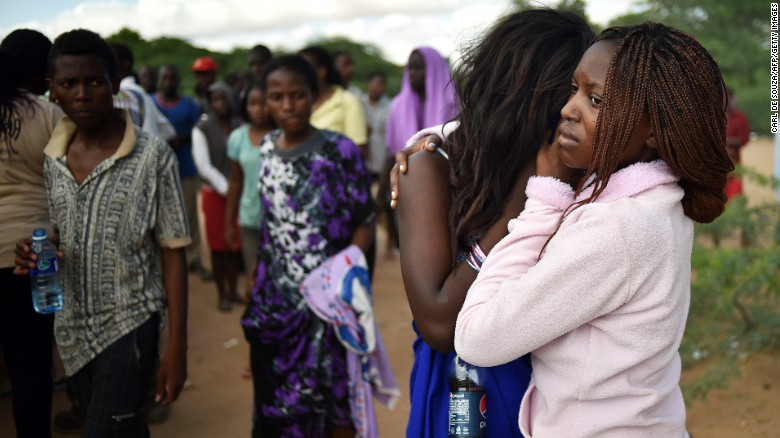 Students mourn those killed in the attack in Garissa on Friday, April 3.