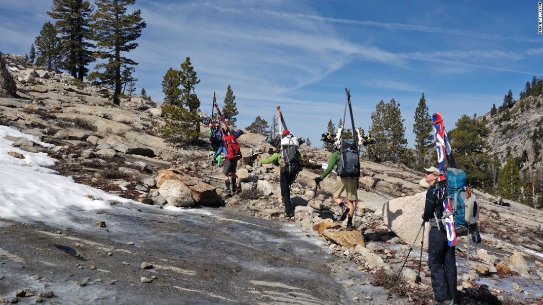 Mary Small, right, looks up Wednesday, April 1, at barren terrain typically populated by skiers in Sequoia National Park.