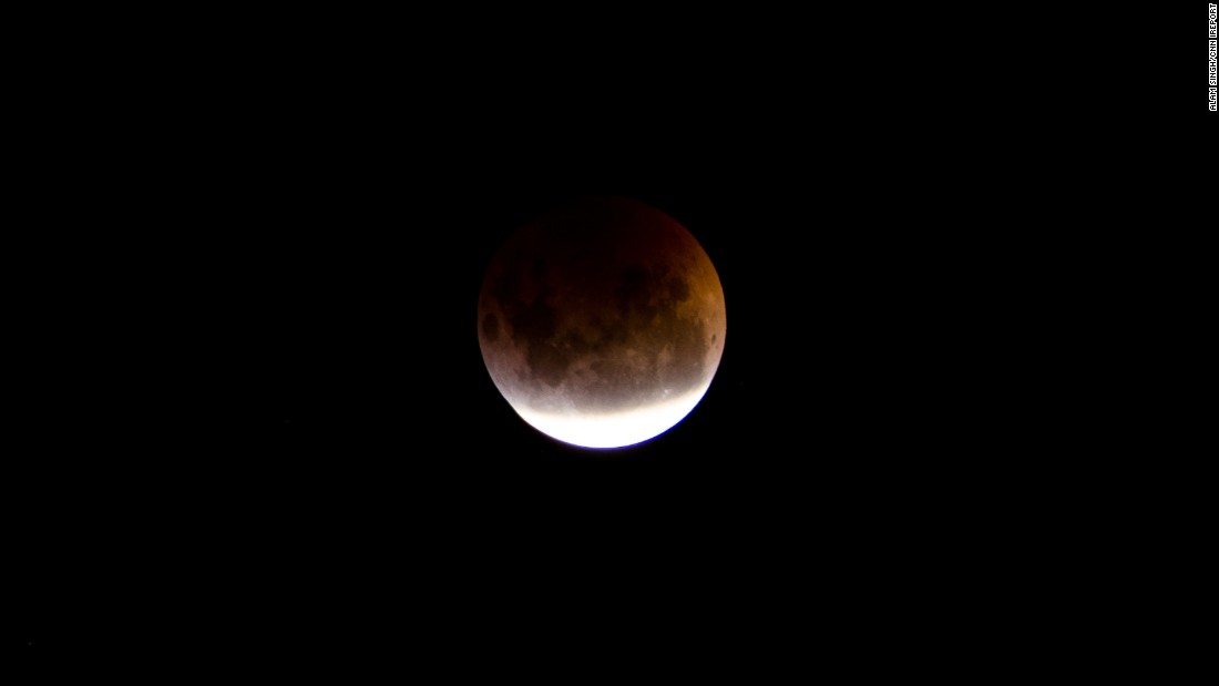 "A bright blood moon hovered above <a href=""http://ireport.cnn.com/docs/DOC-1230967"">Alam Singh's </a>apartment balcony in Melbourne, Australia, on April 4. He was excited to take these shots because he said the city is usually enshrouded by cloud coverage."