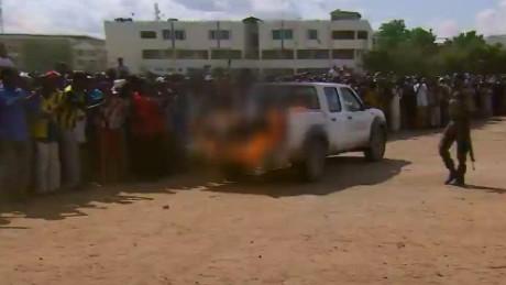 mckenzie pkg kenyan police parade bodies of alleged gunmen_00004527.jpg