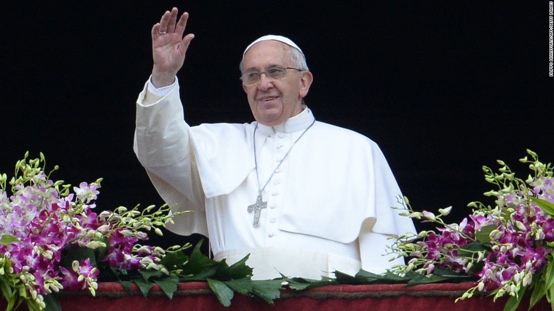 The Pope greets the crowd from St. Peter's Basilica following Easter Mass on Sunday, April 5.