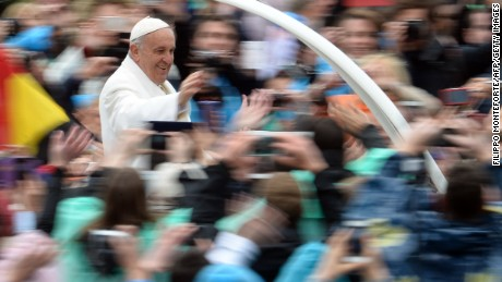 Pope Francis greets the crowd from the popemobile after the Easter Mass on Sunday at the Vatican.