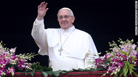 Pope Francis waves to the faithful as he delivers his 'Urbi et Orbi' blessing message from the central balcony of St Peter's Basilica at the end of the Easter Mass on April 5, 2015 in Vatican City, Vatican.