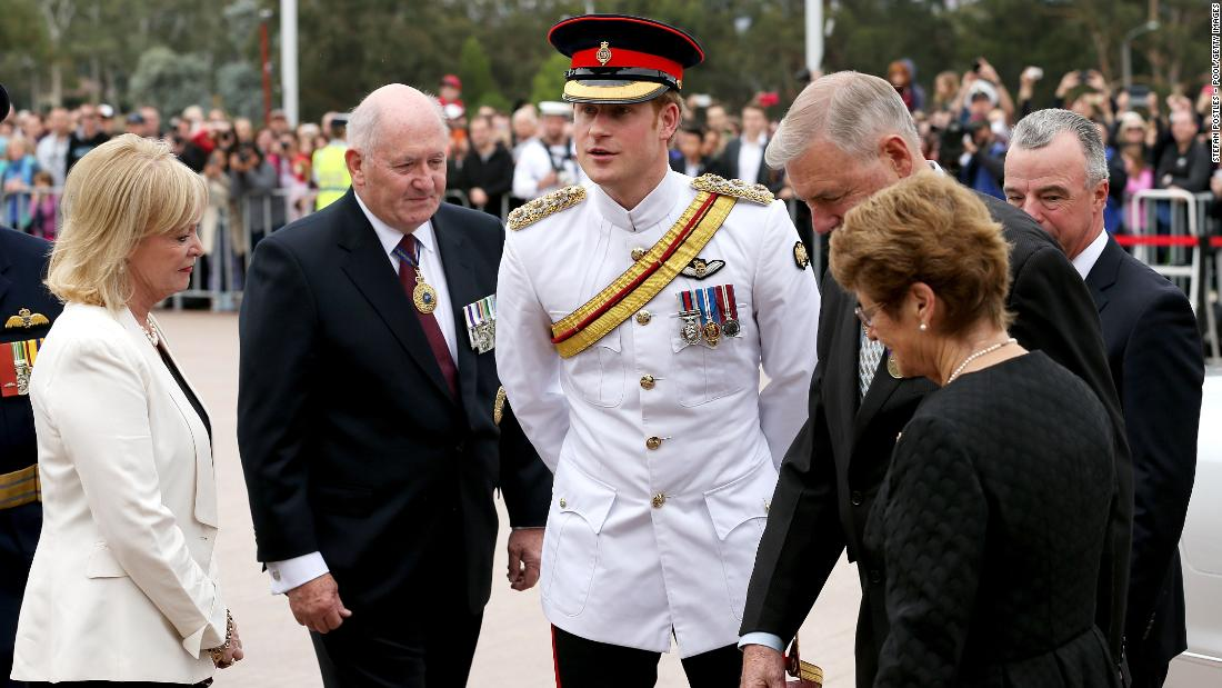 Prince Harry is greeted by Governor-General Sir Peter Cosgrove, second left,  and Chairman of the Council of the War Memorial Ken Doolan, third right, during a visit to the Australian War Memorial on Monday, April 6, in Canberra, Australia. Prince Harry, or Captain Wales as he is known in the British Army, will end his military career with a monthlong secondment, or temporary assignment, to the Australian Defence Force in barracks in Sydney, Perth and Darwin. The prince has grown up in the public eye. Take a look back as the young prince matured into adulthood: