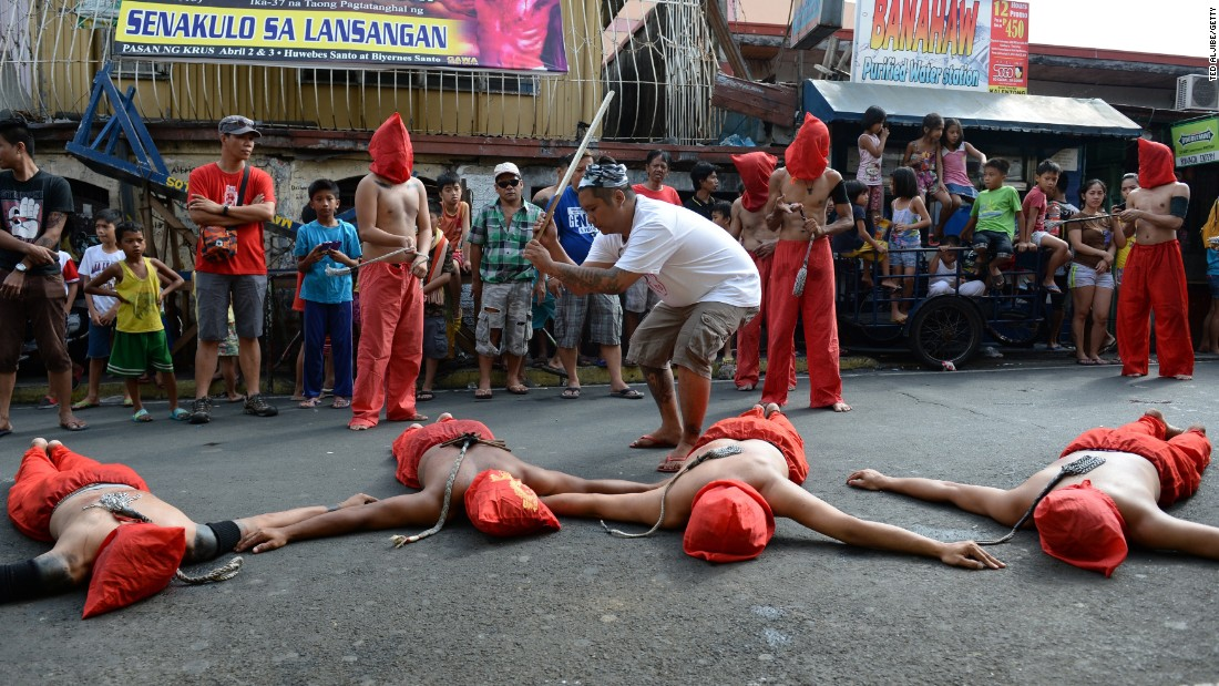 A man whips penitents during celebrations on April 2, 2015.