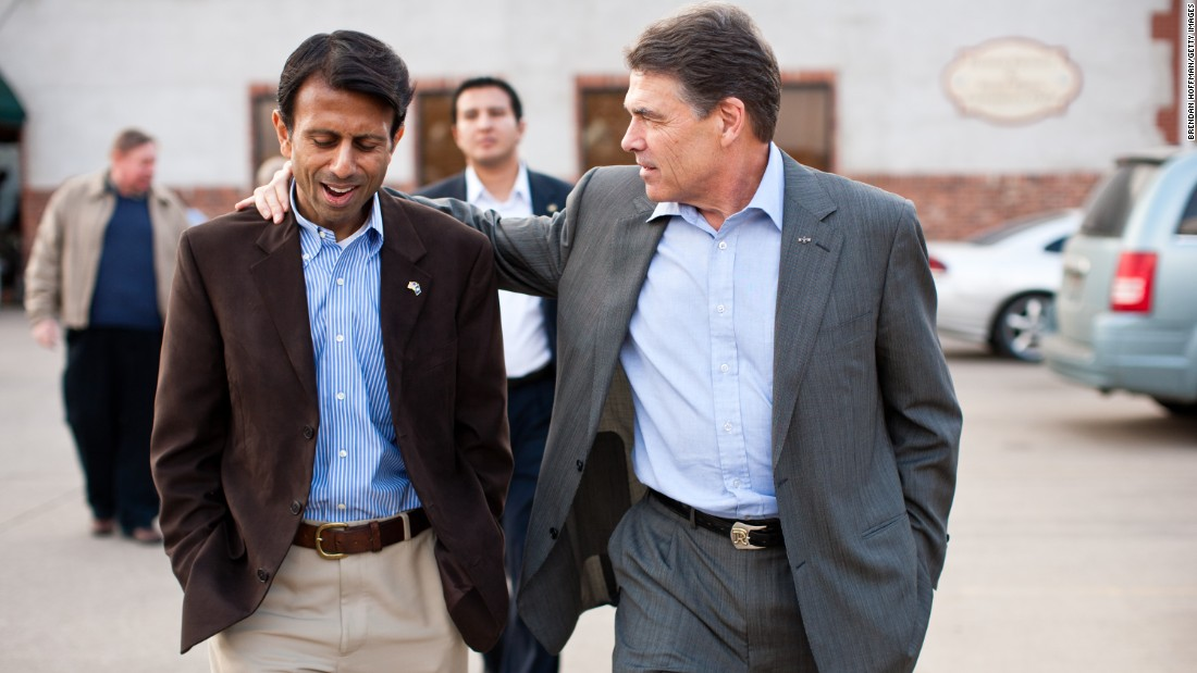 Jindal and Texas Gov. Rick Perry walk together after a Perry presidential campaign meet-and-greet in Muscatine, Iowa, on December 21, 2011.